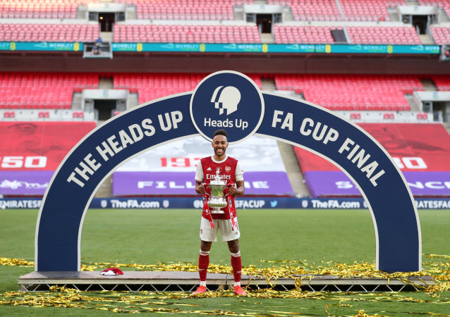 FA Cup Final - Arsenal v Chelsea - Wembley Stadium, London, Britain - August 1, 2020 Arsenal's Pierre-Emerick Aubameyang celebrates with the trophy after winning the FA Cup, as play resumes behind closed doors following the outbreak of the coronavirus disease (COVID-19)