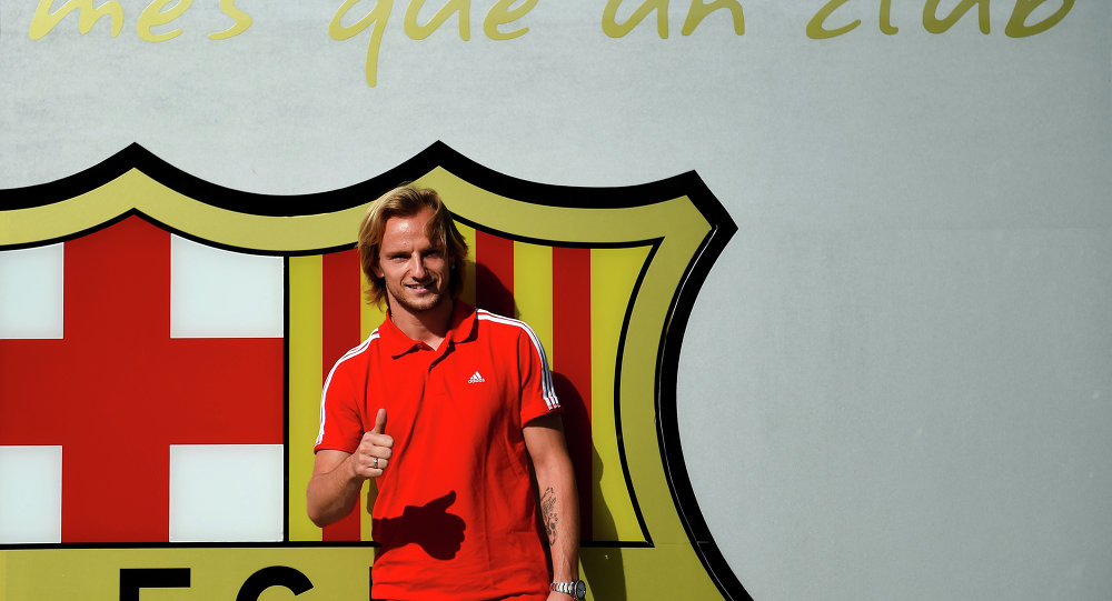 Ivan Rakitic poses before signing as a new player for FC Barcelona