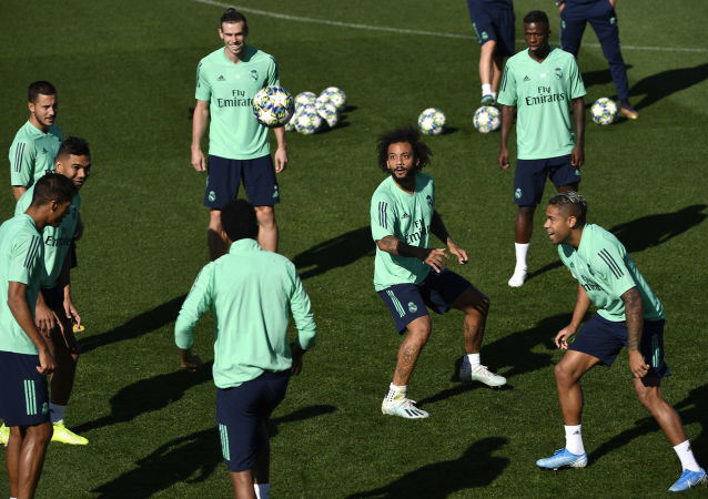 Real Madrid's French defender Raphael Varane, Real Madrid's Brazilian midfielder Casemiro, Real Madrid's Belgian forward Eden Hazard, Real Madrid's Welsh forward Gareth Bale, Real Madrid's Brazilian defender Marcelo Real Madrid's Brazilian forward Vinicius Junior and Real Madrid's Dominicans forward Mariano Diaz attend a training session at the Valdebebas training complex in the outskirts of Madrid, on September 30, 2019