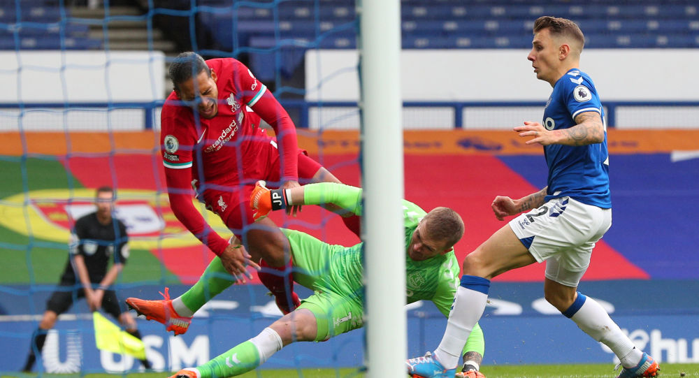 Everton's goalkeeper Jordan Pickford tackles Liverpool defender Virgil van Dijk