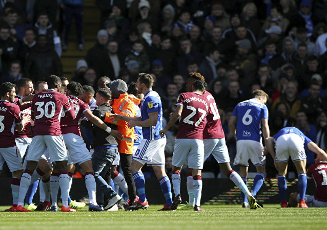 Aston Villa's Jack Grealish sits, nursing a sore head, after being punched by a Birmingham City fan at a game on 10 March 2019