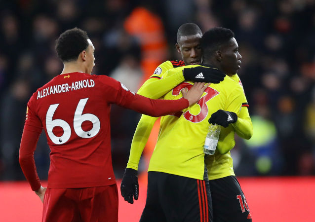Soccer Football - Premier League - Watford v Liverpool - Vicarage Road, Watford, Britain - February 29, 2020  Liverpool's Trent Alexander-Arnold clashes with Watford's Ismaila Sarr and Abdoulaye Doucoure