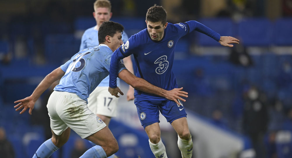 Manchester City's Rodrigo, left, challenges Chelsea's Christian Pulisic during the English Premier League soccer match between Chelsea and Manchester City at Stamford Bridge, London, England, Sunday, Jan. 3, 2021.
