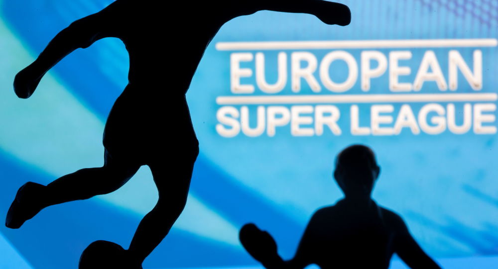 Metal figures of football players are seen in front of the words European Super League in this illustration taken April 20, 2021