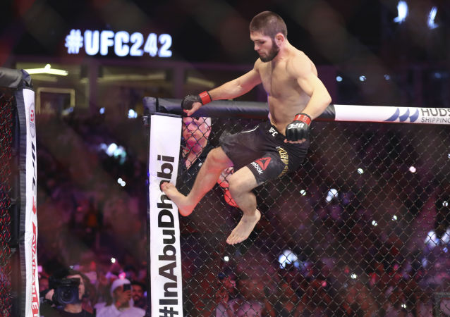 Russian UFC fighter Khabib Nurmagomedov, jumps during Lightweight title mixed martial arts bout at UFC 242, fight against UFC fighter Dustin Poirier, of Lafayette, La., in Yas Mall in Abu Dhabi, United Arab Emirates, Saturday , Sept.7 2019.