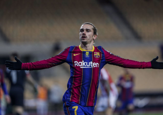 Barcelona's Antoine Griezmann celebrates after scoring his second goal during the Spanish Supercopa final soccer match between FC Barcelona and Athletic Bilbao at La Cartuja stadium in Seville, Spain, Sunday, Jan. 17, 2021.