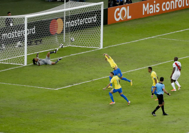 Brazil's Richarlison celebrates scoring from the penalty mark his side's third goal against Peru during the final soccer match of the Copa America