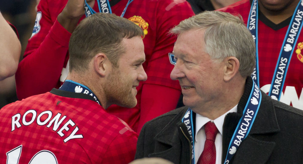 Manchester United's manager Sir Alex Ferguson, right, speaks to striker Wayne Rooney after his last home game in charge of the club, their English Premier League soccer match against Swansea, at Old Trafford Stadium, Manchester, England, Sunday May 12, 2013
