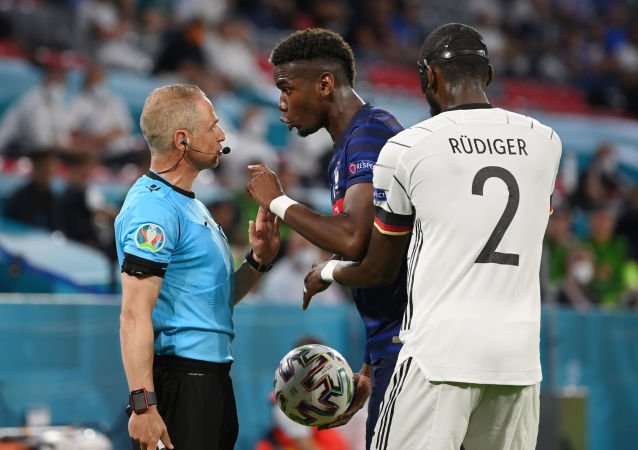 Soccer Football - Euro 2020 - Group F - France v Germany - Football Arena Munich, Munich, Germany - June 15, 2021 France's Paul Pogba remonstrates with the assistant referee as Germany's Antonio Rudiger looks on