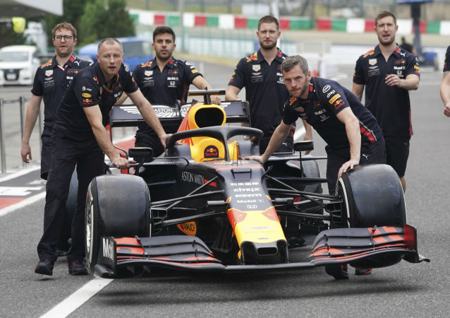 The car of Red Bull driver Max Verstappen of the Netherlands is pushed toward his garage at the Suzuka Circuit in Suzuka, central Japan