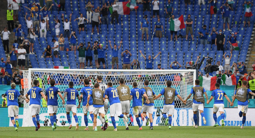 Italy's players celebrate after the match with Wales