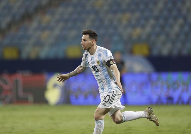 Argentina's Lionel Messi celebrates scoring his side's third goal against Ecuador during a Copa America quarterfinal soccer match at the Olimpico stadium in Goiania, Brazil, Saturday, July 3, 2021