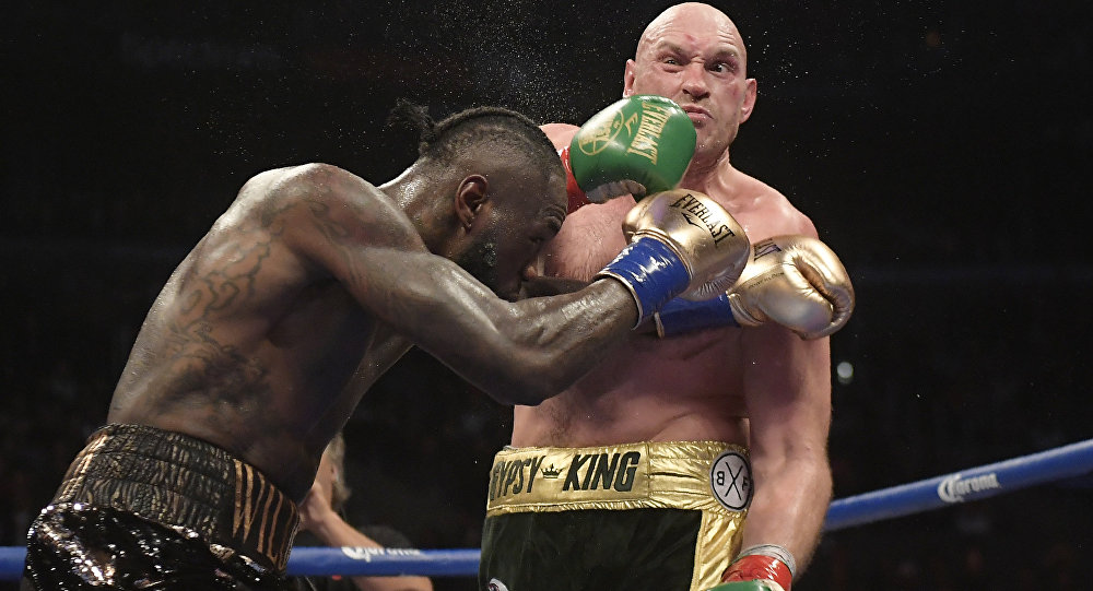 Deontay Wilder, left, connects with Tyson Fury, of England, during a WBC heavyweight championship boxing match Saturday, Dec. 1, 2018, in Los Angeles