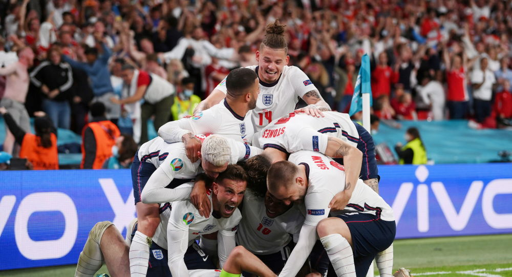 Soccer Football - Euro 2020 - Semi Final - England v Denmark - Wembley Stadium, London, Britain - July 7, 2021 England's Harry Kane celebrates scores their second goal with teammates