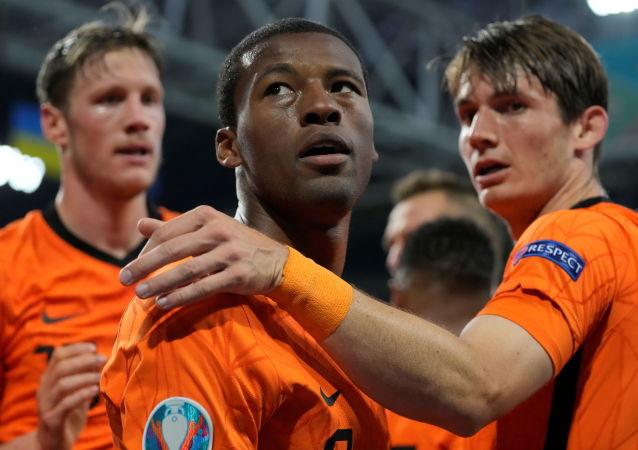 Netherlands v Ukraine - Johan Cruyff Arena, Amsterdam, Netherlands - June 13, 2021 Netherlands' Georginio Wijnaldum celebrates scoring their first goal with teammates