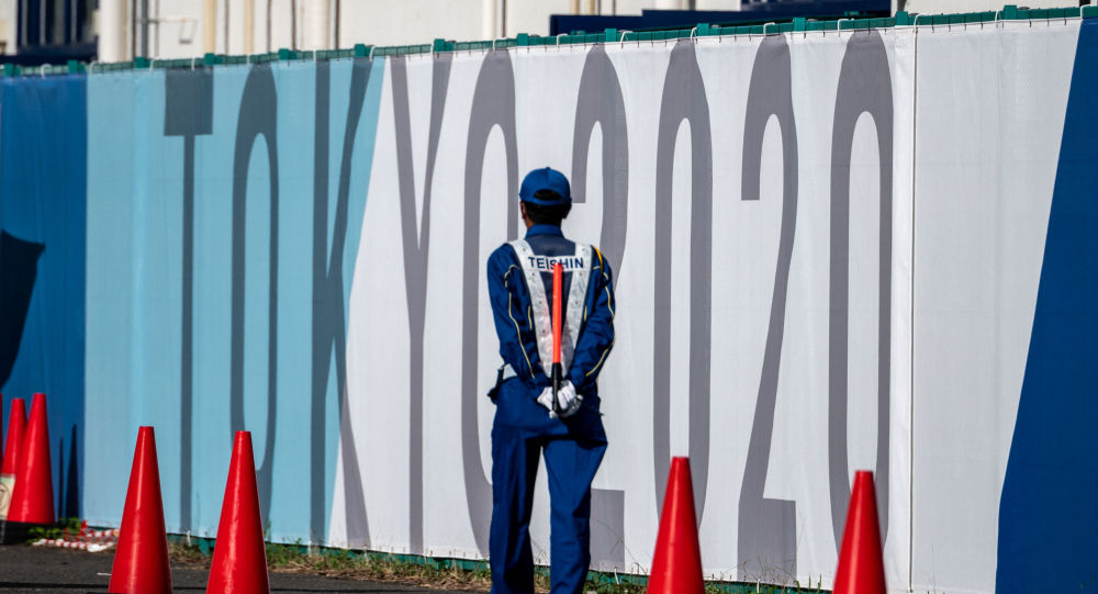 A security guard walks at the Olympic and Paralympic Village in Tokyo on July 15, 2021, ahead of the 2020 Tokyo Olympic Games which begins on July 23.