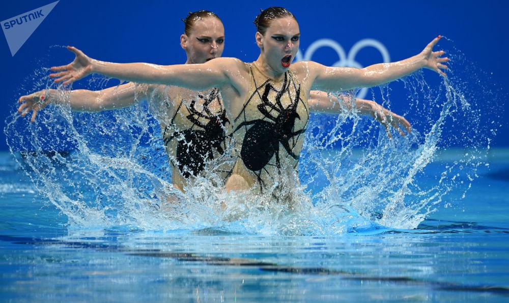 بهترین عکس های این هفته اسپوتنیک/ شناگران زن روسیه در بازی های المپیک توکیو