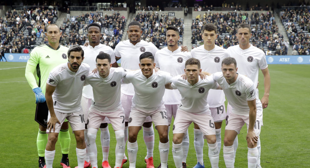 Inter Miami CF line up poses for photos during before the start of their first MLS match, against Los Angeles FC