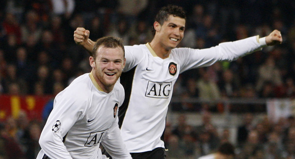 Manchester United's Wayne Rooney, left, celebrates after scoring  against AS Roma with teammate Cristiano Ronaldo, during their Champion's League quarterfinal, first-leg soccer match at the Rome Olympic stadium, Rome, Italy, Tuesday April 1, 2008. Manchester United won 2-0 with the first goal scored by Ronaldo and the second one by Rooney.