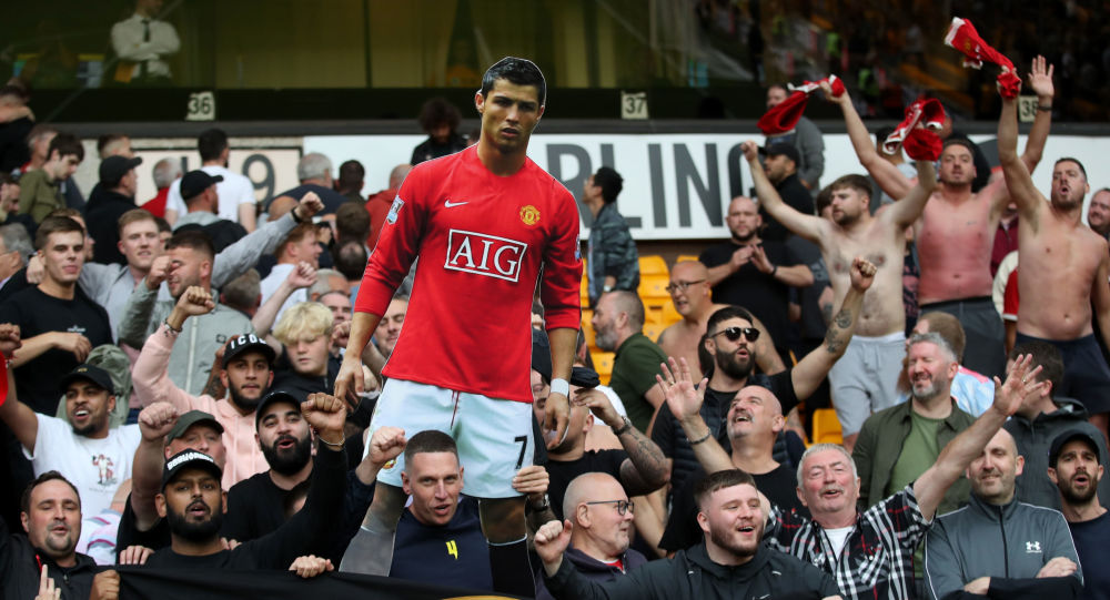 Manchester United fans hold a cutout of Cristiano Ronaldo during the game at Wolves on Sunday 29 August 2021