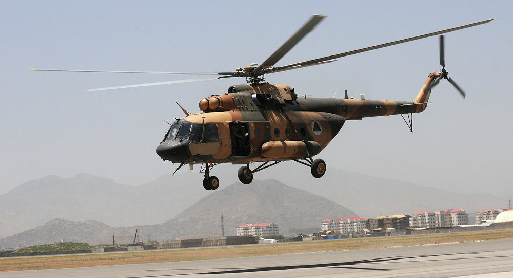 An Afghan Mi-17 helicopter takes off for an air-assault training flight from Kabul International Airport, Afghanistan