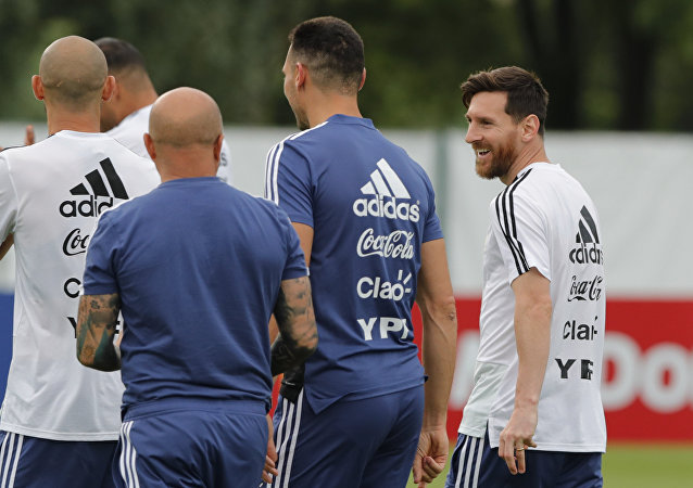 Lionel Messi, right, talks to coach Jorge Sampaoli during a training session of Argentina at the 2018 soccer World Cup in Bronnitsy, Russia, Tuesday, June 19, 2018
