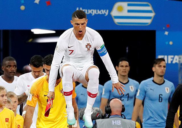 World Cup - Round of 16 - Uruguay vs Portugal - Fisht Stadium, Sochi, Russia - June 30, 2018 Portugal's Cristiano Ronaldo leads the team out before the match