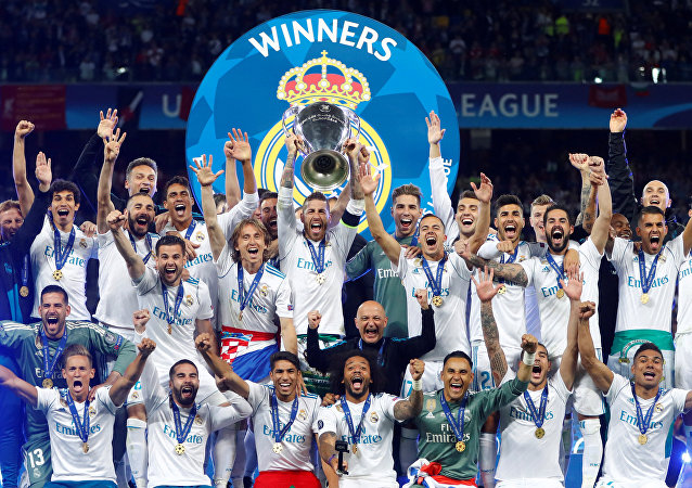 Soccer Football - Champions League Final - Real Madrid v Liverpool - NSC Olympic Stadium, Kiev, Ukraine - May 26, 2018 Real Madrid celebrate winning the Champions League with the trophy