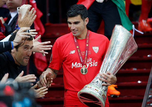 Sevilla's Jose Antonio Reyes celebrates with the trophy and fans after winning the UEFA Europa League Final