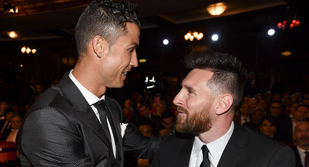 Nominees for the Best FIFA football player, Barcelona and Argentina forward Lionel Messi (R) and Real Madrid and Portugal forward Cristiano Ronaldo (L) chat before taking their seats for The Best FIFA Football Awards ceremony, on October 23, 2017 in London.