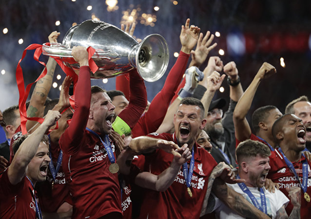 Liverpool's players celebrate with the trophy after winning the Champions League final soccer match between Tottenham Hotspur and Liverpool at the Wanda Metropolitano Stadium in Madrid, Sunday, June 2, 2019. Liverpool won 2-0.