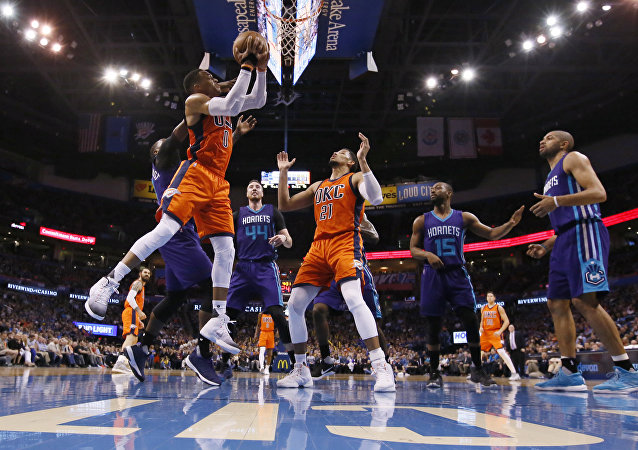 Oklahoma City Thunder guard Russell Westbrook, left, drives to the basket during the second quarter of the team's NBA basketball game against the Charlotte Hornets in Oklahoma City, Sunday, April 2, 2017