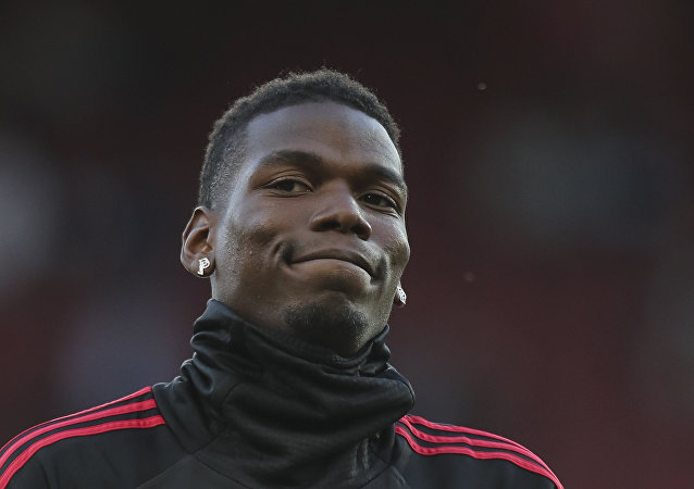 Manchester United's Paul Pogba applauds the fans as he takes part in the warm up prior to the start of the English Premier League soccer match between Manchester United and Leicester City at Old Trafford, in Manchester, England, Friday, Aug. 10, 2018