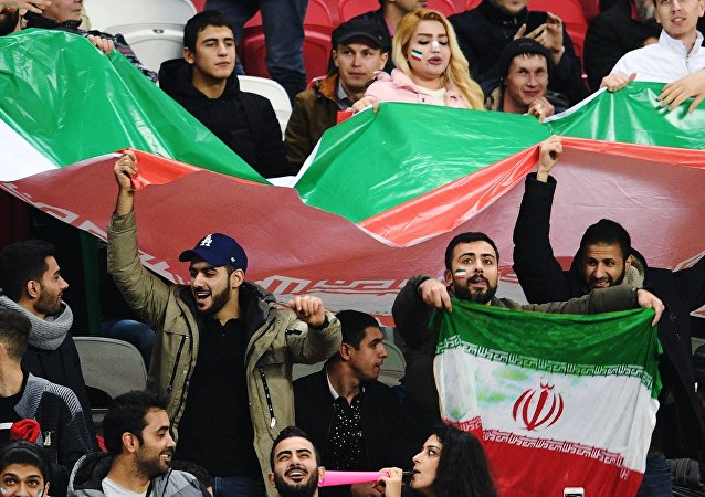 Iranian football fans during a friendly match between Russia and Iran
