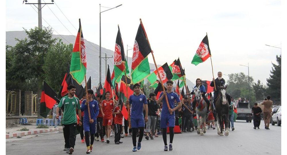 اهتزاز بیرق سه رنگ افغانستان در دیدار ملابرادر با نماینده ملل متحد