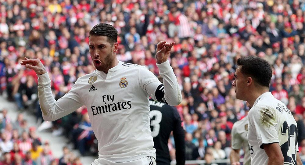 Real Madrid's Sergio Ramos celebrates scoring their second goal with Sergio Reguilon
