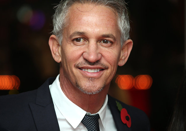 Gary Lineker poses for photographers upon arrival to the world premiere of the film The Hunger Games Mockingjay Part 1 in London, Monday, Nov. 10, 2014