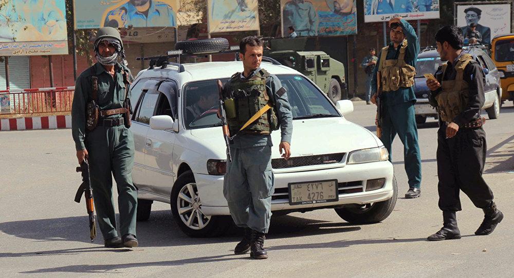 Afghan policemen keep watch in the downtown of Kunduz city, Afghanistan October 3, 2016.